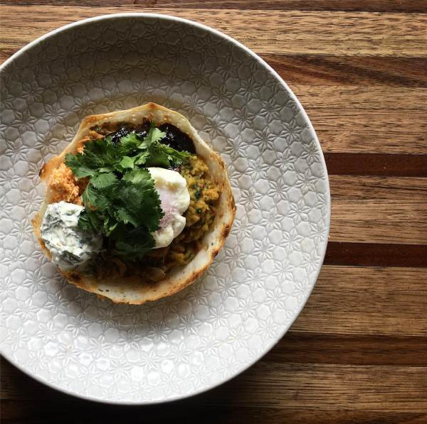 New dish! The egg hopper, with chicken curry, coconut sambal, tamarind chutney, dhal, yoghurt and a poached egg.