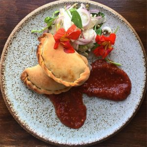 Vegan empanada whatsuuup - Filled with blackbeans and corn, with a fennel, caper and onion salad and tomato jam.