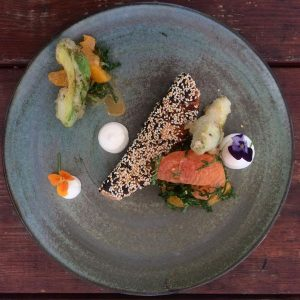 Miso cured Salmon - Sesame crust, tempura avocado, citrus salad, kale, wasabi yoghurt